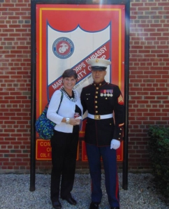 Sandy Burkett and her son, Jon, following his Marine Corp Embassy Guard graduation.